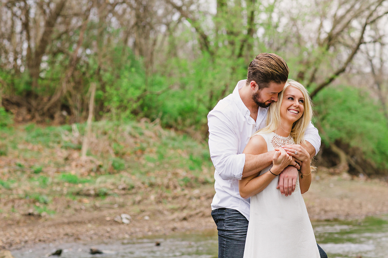couple embraces overland park engagement photography